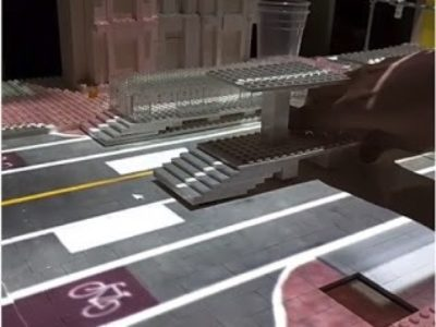 Model of street built with Lego to help residents understand public transport boarding facilities.