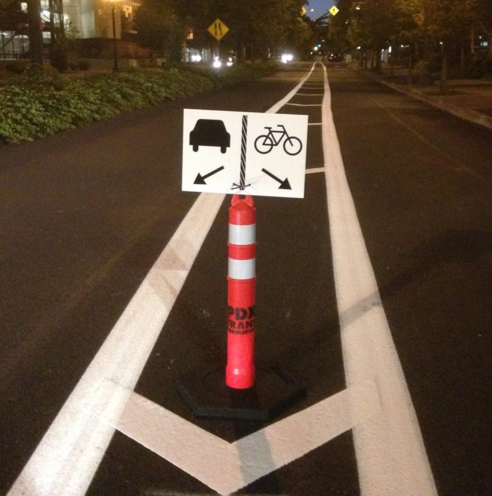 PDX Transformation roadway cone and sign